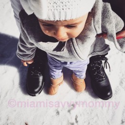Mia stepping on snow for the first time.